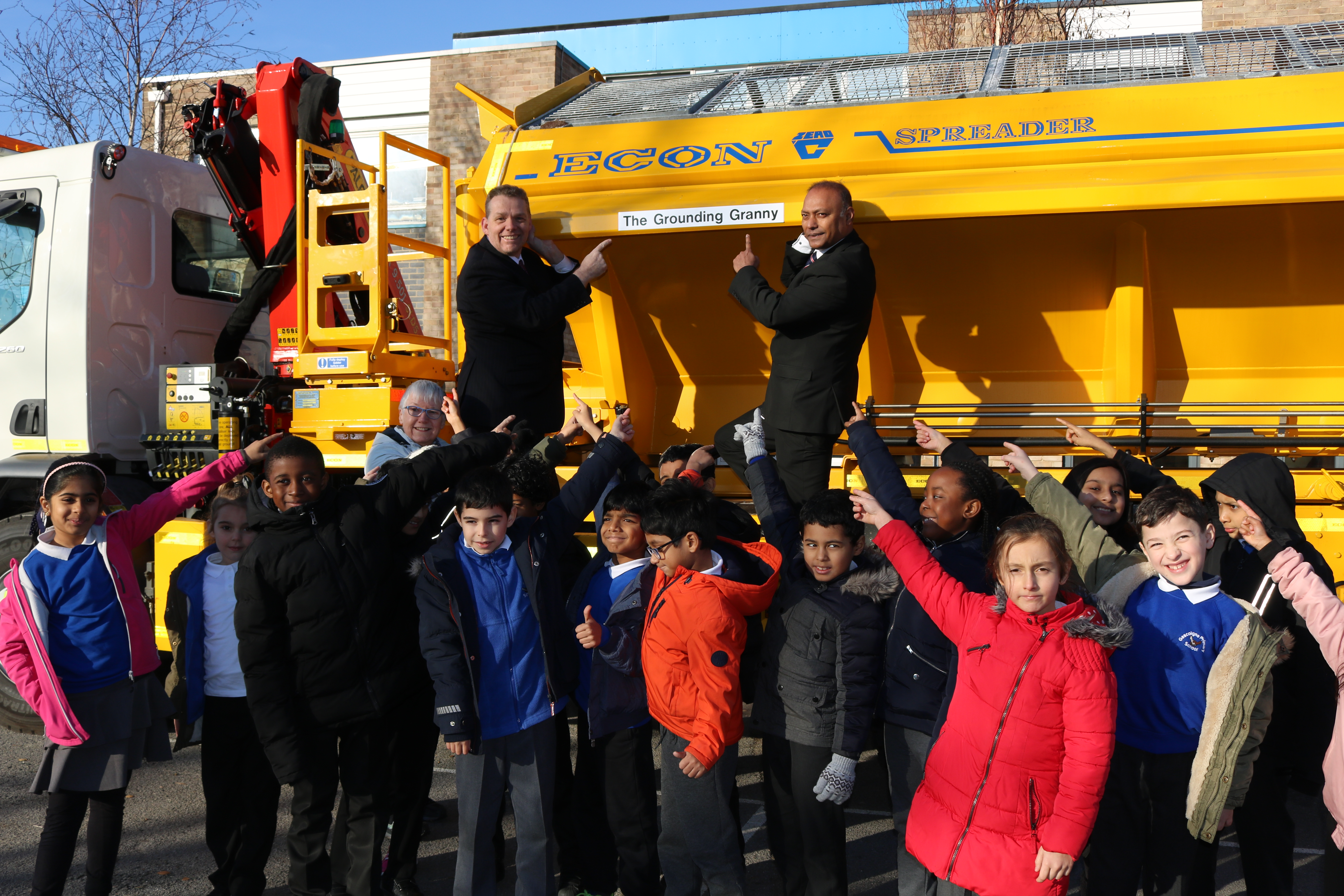 Image of school children and councillors in front of the newly named gritter