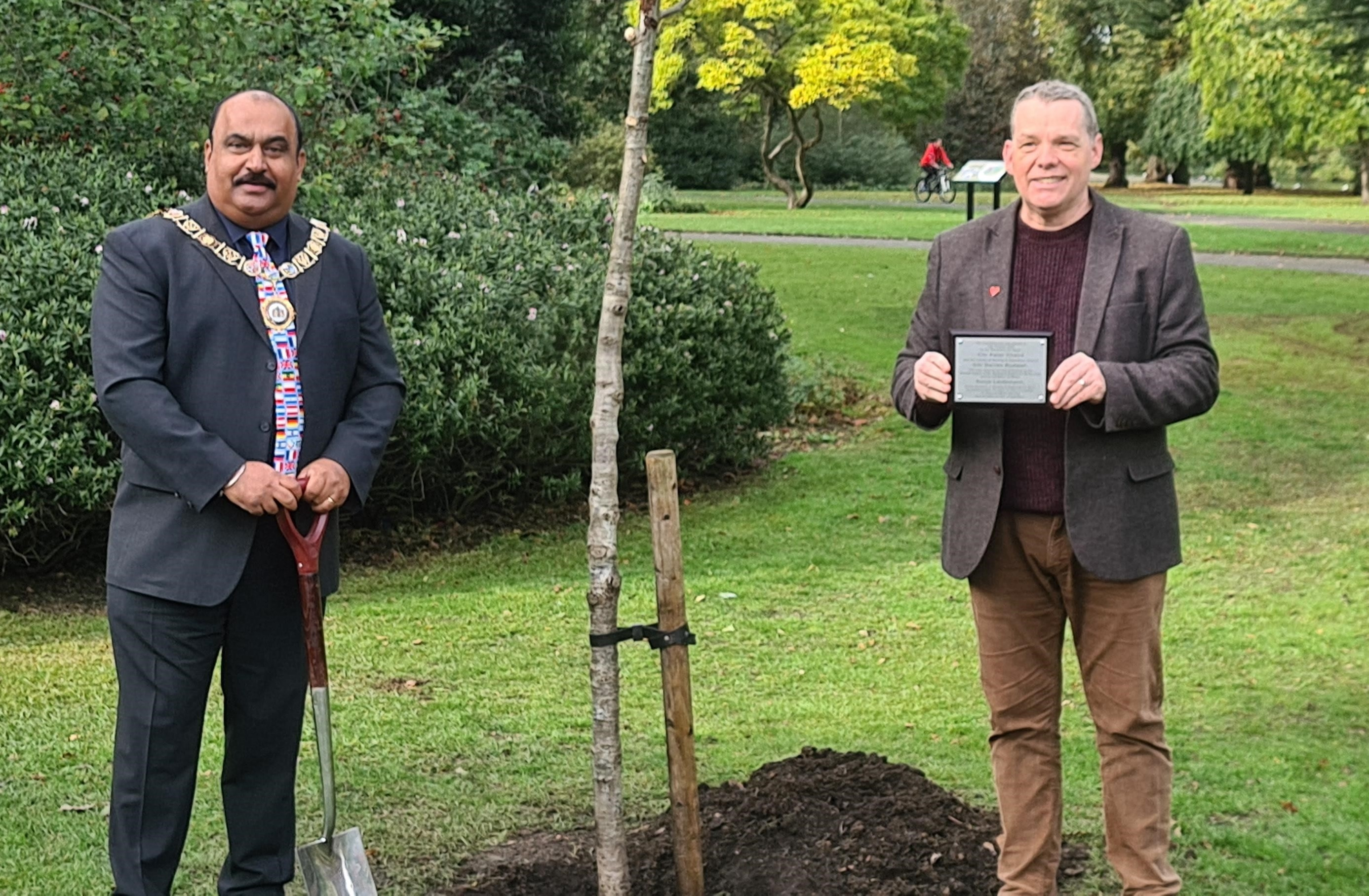 Mayor and Leader of the council by a planted tree with plaque