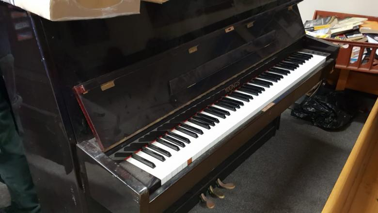 the fly-tipped piano back at the council depot