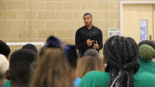 Adam Gemeli talks to students