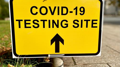 COVID-19 Testing Site sign by the road